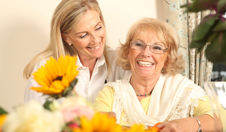 A Heathfield Court resident smiles with a staff member
